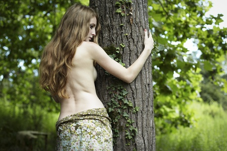 Portrait of romantic woman at the green forest photo