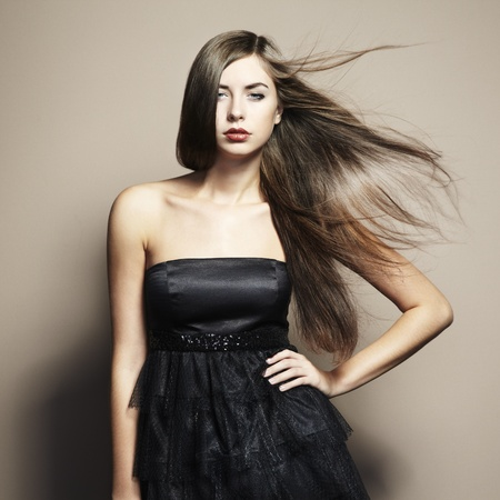 Portrait of young dancing woman with long flowing hair. Fashion photo