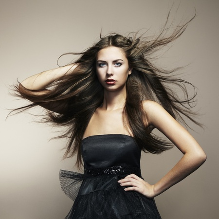 Portrait of young dancing woman with long flowing hair. Fashion photo Stock Photo - 11127191