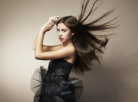 Portrait of young dancing woman with long flowing hair. Fashion photo photo