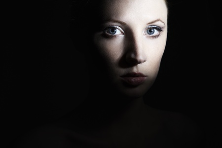 mysterious woman: Mysterious portrait of a beautiful young woman