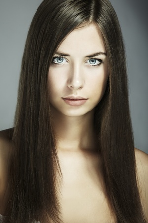 Fashion portrait of young beautiful woman. Close-up photo