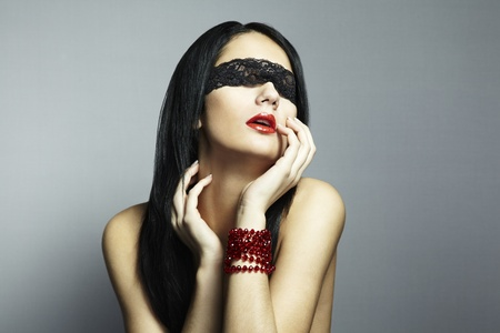 Fashion portrait of the young woman blindfold Stock Photo - 11739129