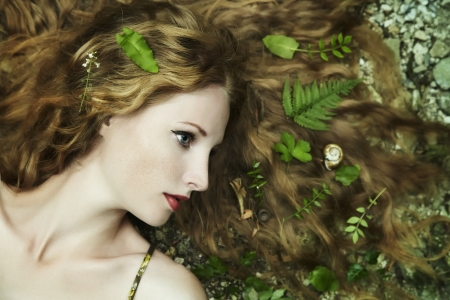 Fashion portrait of young sensual woman in garden photo