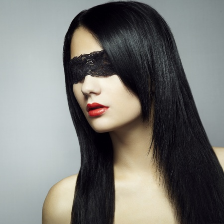Fashion portrait of the young woman blindfold photo