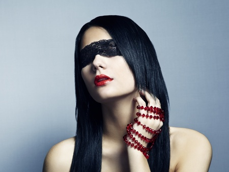 Fashion portrait of the young woman blindfold Stock Photo