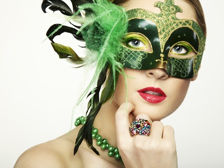 The beautiful young woman in a green mysterious venetian mask Stock Photo - 12441927