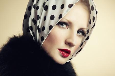 Retro portrait of a beautiful young woman. Fashion photo photo