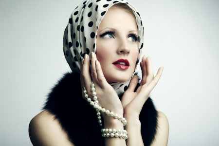 Portrait of young beautiful woman with pearl necklace. Fashion photo photo