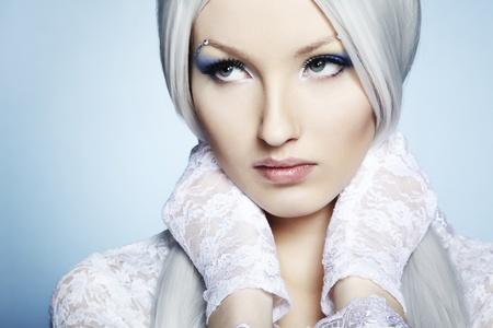 Fashion portrait of a young beautiful blonde woman. Winter Makeup photo