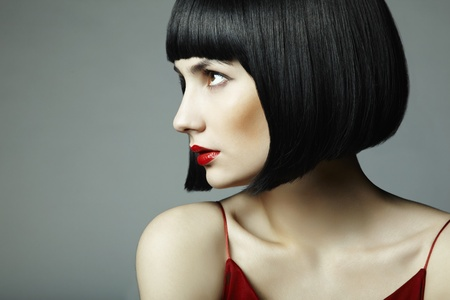 Fashion portrait of a young beautiful dark-haired woman photo