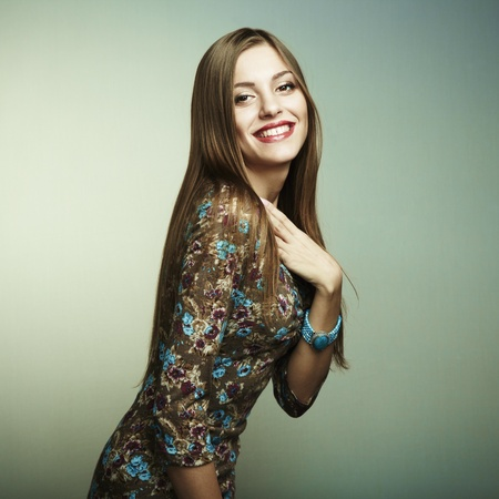 chic woman: Fashion portrait of a happy young woman smiling