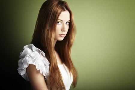 Fashion photo of a young woman with red hair  Close-up Stock Photo - 12914228