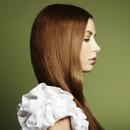 Fashion photo of a young woman with red hair  Close-up Stock Photo - 12914197