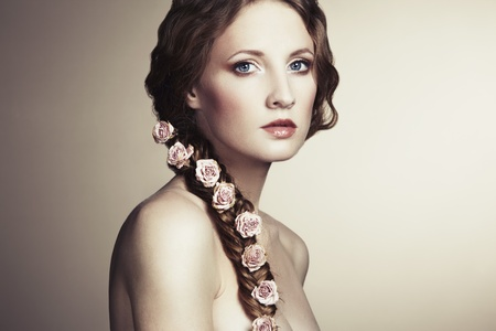 Portrait of a beautiful woman with flowers in her hair  Fashion photo Stock Photo - 13045057