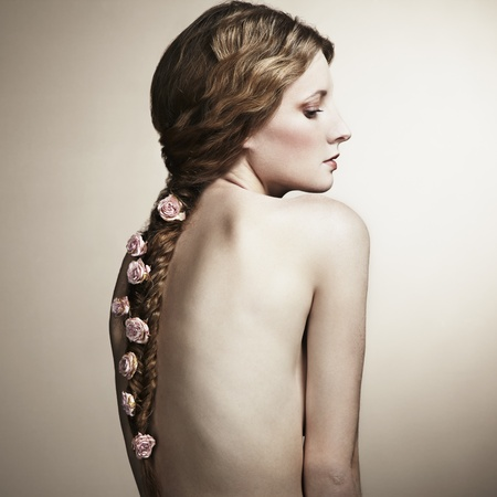 nude back: Portrait of a beautiful woman with flowers in her hair  Fashion photo Stock Photo