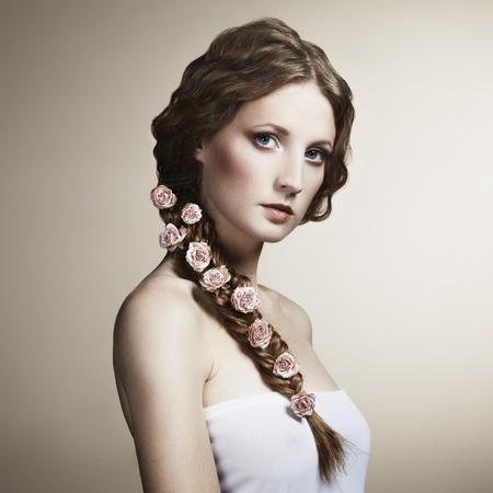 Portrait of a beautiful woman with flowers in her hair  Fashion photo Stock Photo - 13045020