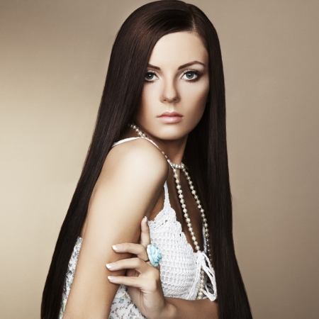 Fashion shoot of beautiful woman with magnificent hair  Studio portrait