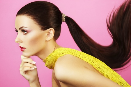 Fashion shot of  beautiful woman with  ponytail  Beauty woman on pink background photo