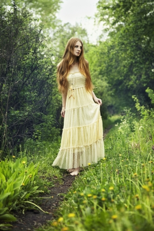 Photo of romantic woman in fairy forest  Beauty summertime photo