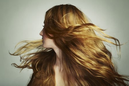 naked young women: Portrait of young beautiful woman with long flowing hair  Fashion photo