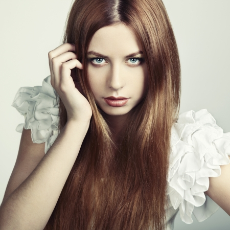 Fashion photo of a young woman with red hair  Close-up portrait photo