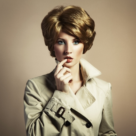 Portrait of beautiful sensual woman with elegant hairstyle. Retro hairdo photo