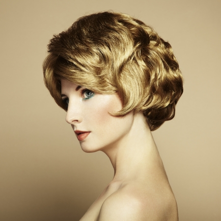 Portrait of beautiful sensual woman with elegant hairstyle. Retro hairdo Stock Photo - 15489543