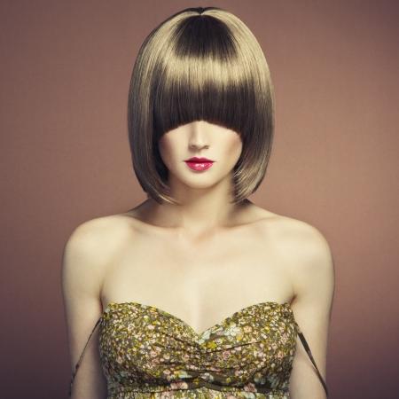 Portrait of beautiful sensual woman with elegant hairstyle. Retro hairdo