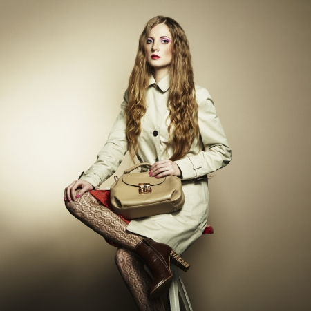 Portrait of a beautiful young woman with a handbag. Stock Photo - 15785876