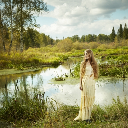 fairy forest: a of romantic woman in fairy forest. Beauty autumn