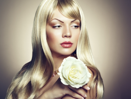 Photo of beautiful woman with magnificent hair. Woman with Rose photo