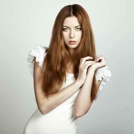 Fashion photo of a young woman with red hair. Close-up photo