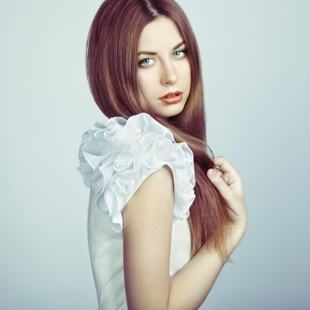 Fashion photo of a young woman with red hair. Close-up Stock Photo - 16333342