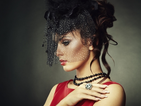 hat with feather: Retro portrait of a beautiful woman. Vintage style.