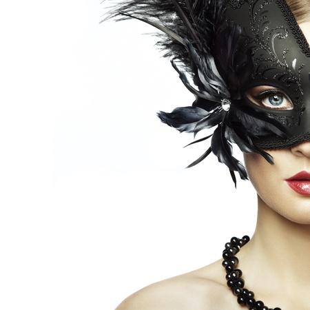 Beautiful young woman in black mysterious venetian mask. Fashion photo Stock Photo