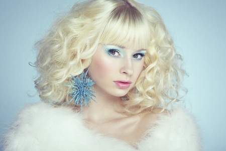 Fashion portrait of a young beautiful blonde woman. Winter style. Winter Makeup photo