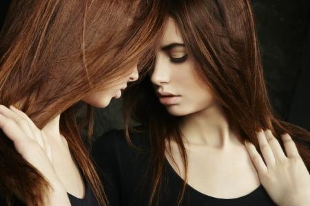 lustful: Beautiful sexy young woman near a mirror. Fashion photo Stock Photo