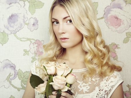 Portrait of a beautiful blonde woman with flowers. Fashion photo photo