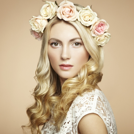 Portrait of a beautiful blonde woman with flowers in her hair. Fashion photo Stock Photo - 17501710