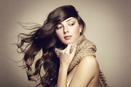Portrait of a beautiful young woman with scarf. Fashion photo