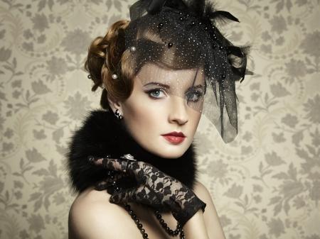 Retro portrait of  beautiful woman. Vintage style. Fashion photo Stock Photo - 18598079