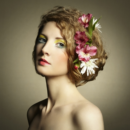 Beautiful young woman with delicate flowers in their hair. Spring photos photo