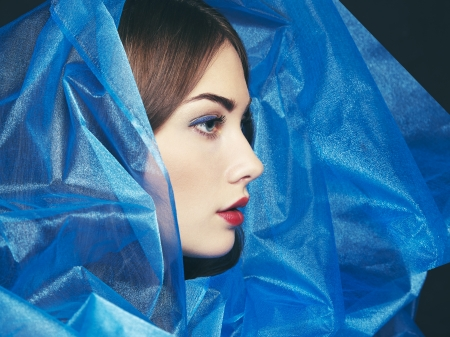 Fashion photo of beautiful women under blue veil. Beauty portrait Stock Photo - 19025551