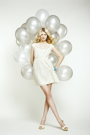 Fashion photo of beautiful woman with balloons. Girl posing. Studio photo photo