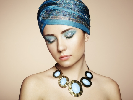Portrait of young beautiful woman with jewelry. Beauty photo Stock Photo