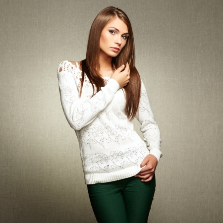 Photo of beautiful young woman in white jacket photo