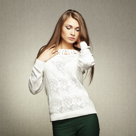 Photo of beautiful young woman in white jacket  Fashion photo photo