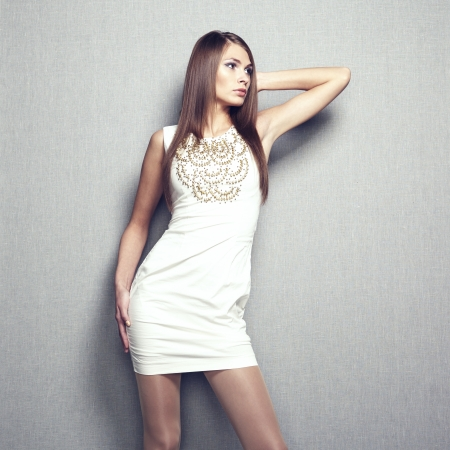 Fashion photo of young sensual woman in beige dress  Fashion photo photo
