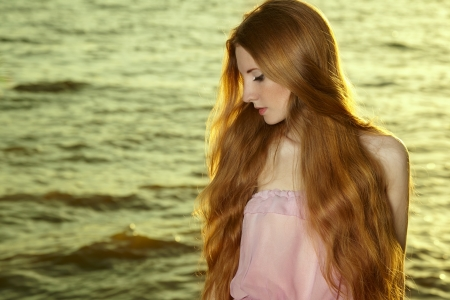 sea nymph: Beautiful redhead girl at pond  Beauty summertime Stock Photo